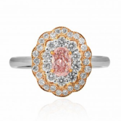 Fancy Intense Pink Oval Diamond Halo Ring mounted in Platinum and 18K rose gold
